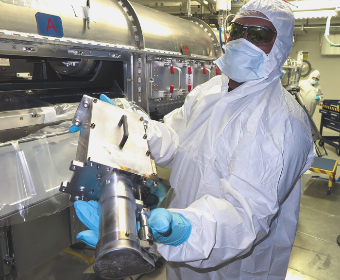 Operator Removes Neutron Imager Snout from a Diagnostic Instrument Manipulator