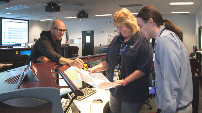 Lisa Burrows and Colleagues Prepare for Experiment