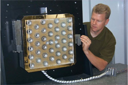 Scott Winters checking a deformable mirror