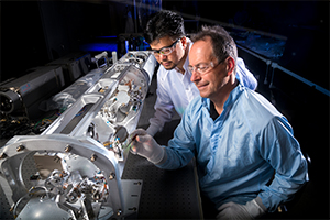 "<h3>Optical Thomson Scattering Diagnostic</h3>An extensive suite of diagnostics is required at NIF to accommodate its diverse experiments. Shown here, engineering technical associates Gene Frieders (front) and Gene Vergel de Dios work on the optical Thomson scattering diagnostic for recording time-resolved spectra from experiments. (Photo by Randy Wong.) <br/><br/><a href=""content/assets/images/media/photo-gallery/large/H5A9995A.jpg"" target=""_blank"">Download hi-res image</a><br/><a href=""/media/photo-gallery?id=h5a9995a"">Direct Link</a>"