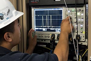 "<h3>Target Diagnostics</h3>A target diagnostics operator verifies signal integrity after an adjustment. NIF has about 60 nuclear, optical, and x-ray diagnostics that together provide 300 channels for experimental data.<br/><br/><a href=""content/assets/images/media/photo-gallery/large/fidu_2013-050636.jpg"" target=""_blank"">Download hi-res image</a><br/><a href=""/media/photo-gallery?id=2013-050636"">Direct Link</a>"