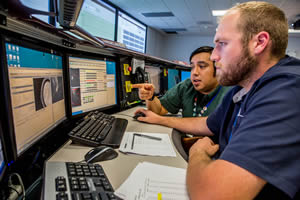 "<h3>Checking Shot Results</h3>In the NIF Control Room, Target Area Coordinator Rodrigo Miramontes-Ortiz (left) and Beam Control Operator Robert Blanton examine the shot data following NIF's 300th shot in Fiscal Year 2015. The shot was one of a series of polar direct-drive shots to operationally qualify a new continuous phase plate (beam-smoothing optic) design (see <a href=""/news/science-technology/2015/october""> ""Shaping NIF's Beams for Direct-Drive Experiments""</a>). Credit: Jason Laurea<br/><br/><a href=""content/assets/images/media/photo-gallery/web/P1487128-lg.jpg"" target=""_blank"">Download hi-res image</a><br/><a href=""/media/photo-gallery?id=p1487128"">Direct Link</a>"