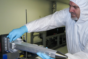 "<h3>ARC X-ray Imaging System</h3>Technician Tim Cunningham prepares the Advanced Radiographic Capability (ARC) X-ray Imaging System (AXIS) diagnostic snout for its first data shot on March 1, 2016. AXIS is a dual-axis x-ray camera designed to acquire two high-resolution Compton radiographs during a single NIF shot. Compton radiography is an important diagnostic for inertial confinement fusion (ICF), as it provides a means to measure the density and asymmetries of the deuterium-tritium fuel in an ICF capsule near the time of peak compression (see <a href=""/news/experimental-highlights/2016/march""> &ldquo;Testing NIF&rsquo;s Dual-Axis Imager&rdquo;</a>). Credit: James Pryatel<br/><br/><a href=""content/assets/images/media/photo-gallery/web/P2328105-lg.jpg"" target=""_blank"">Download hi-res image</a><br/><a href=""/media/photo-gallery?id=p2328105"">Direct Link</a>"