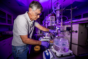 "<h3>Anti-Reflective Coating for NIF Optics</h3>LLNL Chemist Paul Ehrmann prepares an anti-reflective coating used on NIF optics. The coating was developed to overcome energy-robbing reflections and limit damage from the rear surface of the facility's grating debris shields, or GDSs. The colloidal silica particle coating, made by a sol-gel chemical process, was applied to the grating surface of the GDS. The particles were treated with a chemical that modifies the surface, making them more immune to changes in humidity and other environmental factors (see <a href=""/news/science-technology/2017/april#gds"">  ""Next-Generation NIF Optics Boost Energy and Limit Damage""</a>). Credit: Jason Laurea<br/><br/><a href=""content/assets/images/media/photo-gallery/web/_Q9A1335-lg.jpg"" target=""_blank"">Download hi-res image</a><br/><a href=""/media/photo-gallery?id=_q9a1335"">Direct Link</a>"