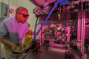 "<h3>Additive Manufacturing Reveals New Physics</h3>Ibo Matthews inspects an <em>in situ</em> diagnostics test bench his team developed for studying laser-driven powder bed fusion additive manufacturing. High-speed thermal and optical mapping of the laser-powder interaction has enabled the team to reveal new physics associated with the process and help guide high-performance computing simulations (see <a href=""/news/science-technology/2016/july#3d_printing""> &ldquo;3D Printing Could Revolutionize Laser Development&rdquo;</a>). Credit: Julie Russell.<br/><br/><a href=""content/assets/images/media/photo-gallery/web/ibo_matthews-lg.jpg"" target=""_blank"">Download hi-res image</a><br/><a href=""/media/photo-gallery?id=ibo_matthews"">Direct Link</a>"