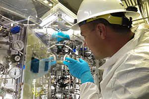 "<h3>Gas for NIF Targets </h3>A NIF Cryogenic System technician takes measurements in the target positioner gas manifold. The gas manifold is used to purge air and fill NIF target capsules with gases such as helium and deuterium. <br/><br/><a href=""content/assets/images/media/photo-gallery/web/p1042003-lg.jpg"" target=""_blank"">Download hi-res image</a><br/><a href=""/media/photo-gallery?id=p1042003"">Direct Link</a>"