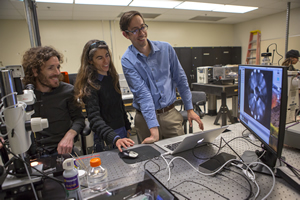 "<h3>Testing New Ideas for Targets </h3>In LLNL's High Energy Density (HED) Science Center Technology Facility, Physics staff members Marius Millot (left), Federica Coppari, and Dayne Fratanduono observe a diamond anvil cell, similar to the ones used for their <a href=""/news/papers-presentations/2018/february""> recent discovery of superionic water ice</a> (technician Renee Posadas Soriano is in the background). Innovative experiments often require testing and trying before viable concepts for new experiments and targets emerge. The HED Science Center Technology Facility in Bldg. 161 offers <a href=""https://heds-center.llnl.gov/"" target=""_blank""> HED Science Center</a> physicists and outside collaborators tools, instrumentation and support. Credit: Jason Laurea <br/><br/><a href=""content/assets/images/media/photo-gallery/web/p3351158-lg.jpg"" target=""_blank"">Download hi-res image</a><br/><a href=""/media/photo-gallery?id=p3351158"">Direct Link</a>"