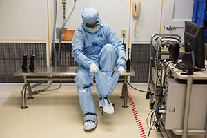 "<h3>Suiting Up</h3>NIF's optics must be assembled and maintained under stringent clean-room conditions in the Optics Assembly Building; when hit by a NIF laser beam, a speck of dust can initiate a damage site that can grow during later shots and eventually disable the optic (see <a href=""/news/science-technology/2015/february"">""Keeping NIF Optics on the Job.""</a>) About 40,000 optics guide, reflect, amplify and focus NIF's 192 laser beams onto the tiny fusion target. Credit: Damien Jemison<br/><br/><a href=""content/assets/images/media/photo-gallery/web/p946962-lg.jpg"" target=""_blank"">Download hi-res image</a><br/><a href=""/media/photo-gallery?id=p946962"">Direct Link</a>"