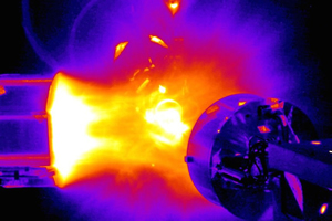 "<h3>Validating Electromagnetic Pulse Codes</h3>Shot-time image from the NIF Target Chamber of an x-ray source creating a plasma wind on system-generated electromagnetic pulse (SGEMP) test objects. The SGEMP campaign, led by Sandia National Laboratories and the UK&rsquo;s Atomic Weapons Establishment, is part of NIF&rsquo;s National Security Applications mission; its goal is to help validate simulation codes designed to determine the effects of SGEMP on various materials (see <a href=""/news/experimental-highlights/2015/january"">&ldquo;NIF Experiments Help Validate Electromagnetic Pulse Codes&rdquo;</a>).<br/><br/><a href=""content/assets/images/media/photo-gallery/web/sgemp_shot-lg.jpg"" target=""_blank"">Download hi-res image</a><br/><a href=""/media/photo-gallery?id=sgemp_shot"">Direct Link</a>"