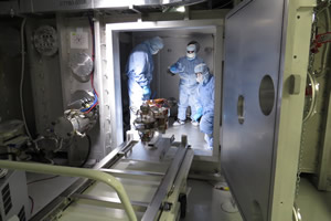 "<h3>Qualifying a Target Alignment Sensor</h3>The NIF alignment team installs the TAS3 Target Alignment Sensor in a vacuum chamber in preparation for qualification testing. The TAS is a precision optical device inserted into the Target Chamber center to facilitate both beam and target alignment. The sensor aligns the beams and target to a common referenced coordinate system (see <a href=""/news/efficiency-improvements/2016/july""> &ldquo;New Target Alignment Sensor Installed on NIF&rdquo;</a>).<br/><br/><a href=""content/assets/images/media/photo-gallery/web/tas_arc-lg.jpg"" target=""_blank"">Download hi-res image</a><br/><a href=""/media/photo-gallery?id=tas_arc"">Direct Link</a>"
