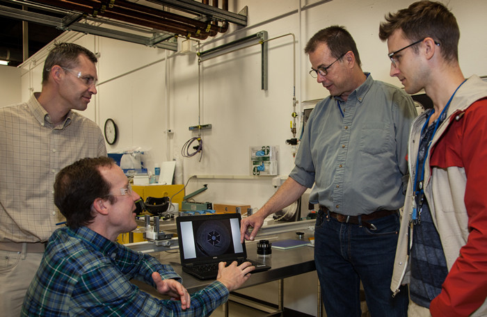 Members of the LLNL Fiber Laser Team Examine Fiber Image