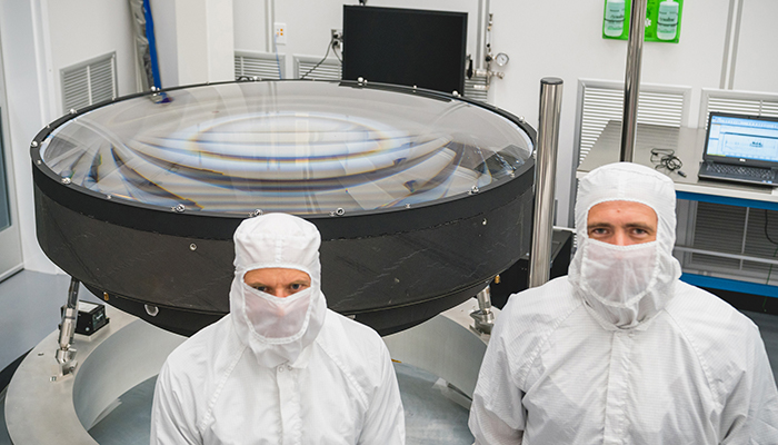 Photo of Vincent Riot, Justin Wolfe with the LSST main lens assembly