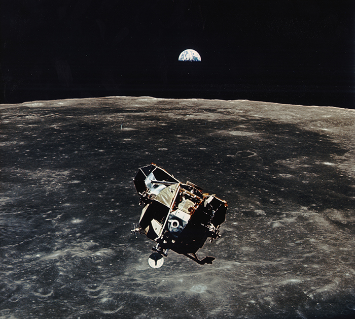 Photo of lunar module Eagle over the moon during Apollo 11, with Earth in the background