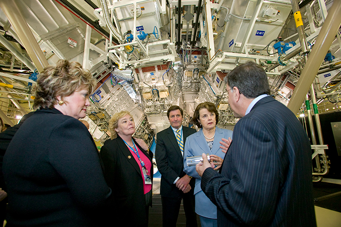 Photo of Rep. Ellen Tauscher, Rep. Zoe Lofgren, Rep. John Garamendi, and Sen. Dianne Feinstein receiving a tour of the Target Chamber from then-NIF Director Ed Moses during NIF's dedication ceremonies