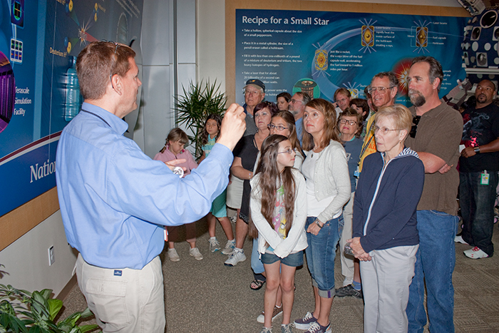 Photo of NIF visitors starting their tour in the lobby during NIF's dedication festivities