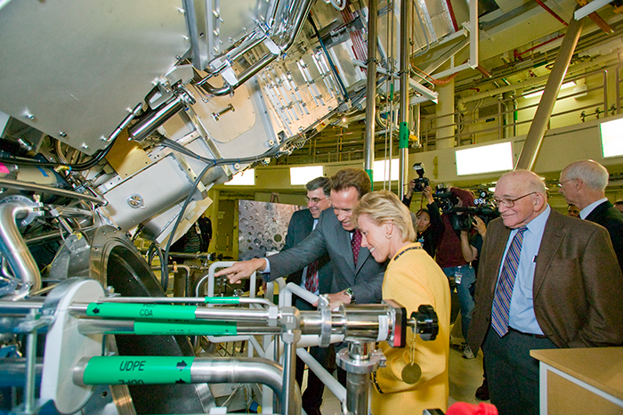 Photo of Gov. Schwarzenegger and other dignitaries getting a close-up look at NIF during NIF's dedication ceremonies