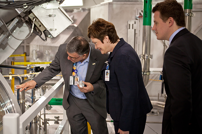 Photo of Ed Moses, Ellen Tauscher, and Kevin Lawson touring the Target Chamber