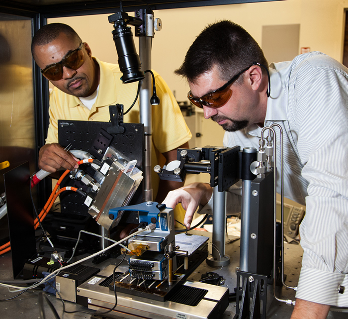 Brad Baker and Ibo Matthews Adjust Laser Array