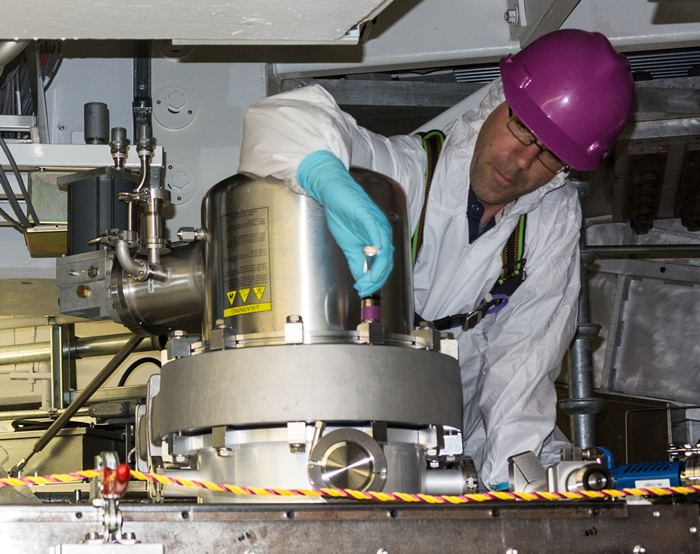 Technicians Install Cryo Pumps