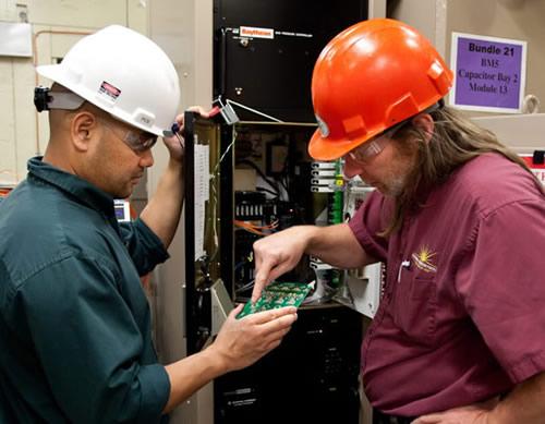 Technicians Examine Circuit Board