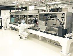Technician Installing Preamplifier Module